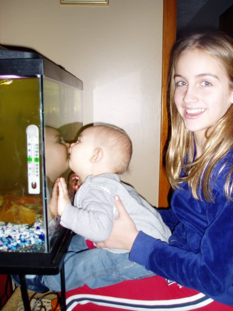 Kissing fishies with Sophia