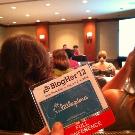 Dagmar Bleasdale holding her BlogHer'12 badge in a session