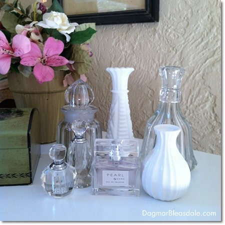 collection of vintage glass items and vases