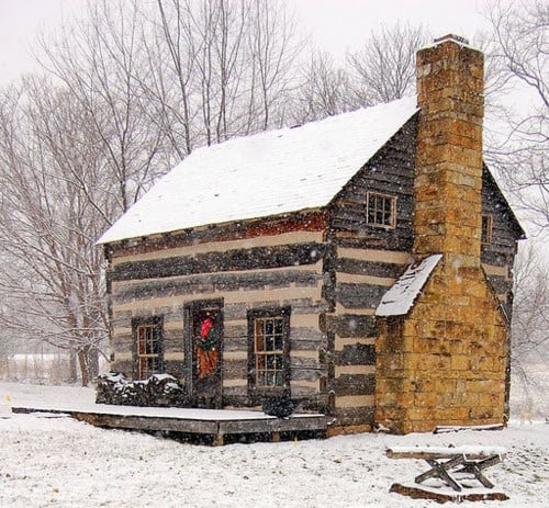 pretty cottage in the snow, with wreath