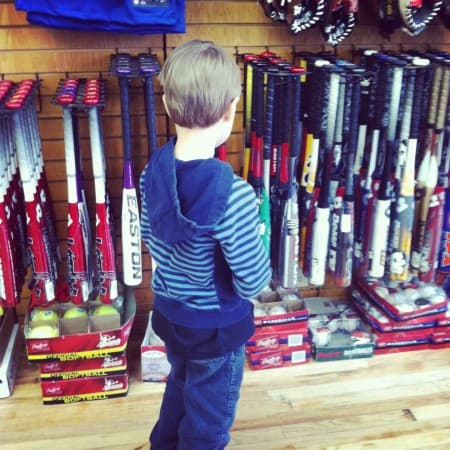 boy in sports equipment store