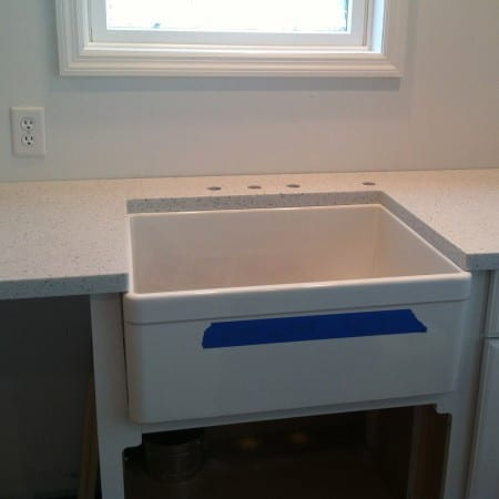 light gray countertop and farm sink