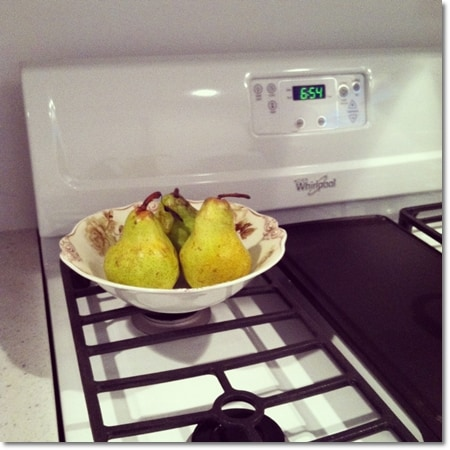 pears in vintage bowl on stove