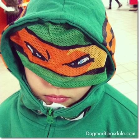 boy in Ninja Turtle hooded sweatshirt
