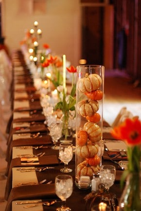Thanksgiving table decor, pumpkins in glass vase