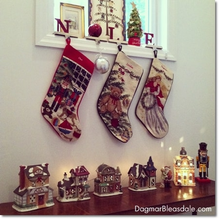 Christmas stockings hanging on window sill