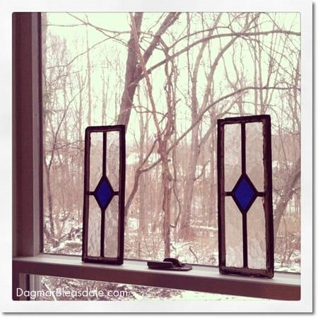 two little vintage lead windows leaning on window frame