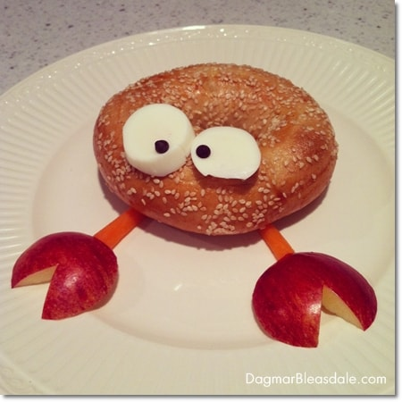 crab made out of bagel, egg, apples, and carrots