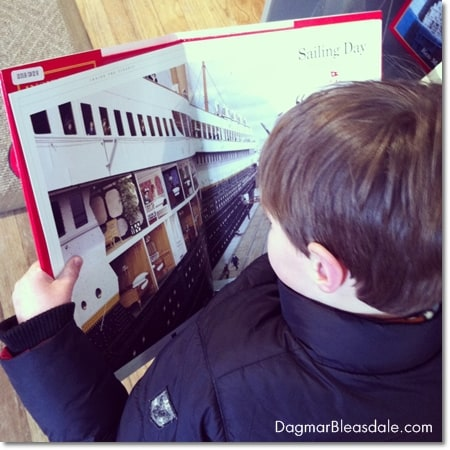 boy reading Titanic book