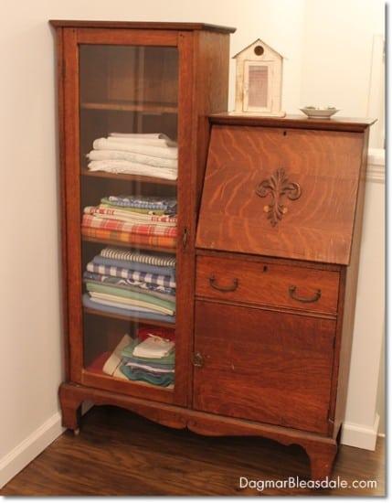 vintage curio cabinet now a linen closet