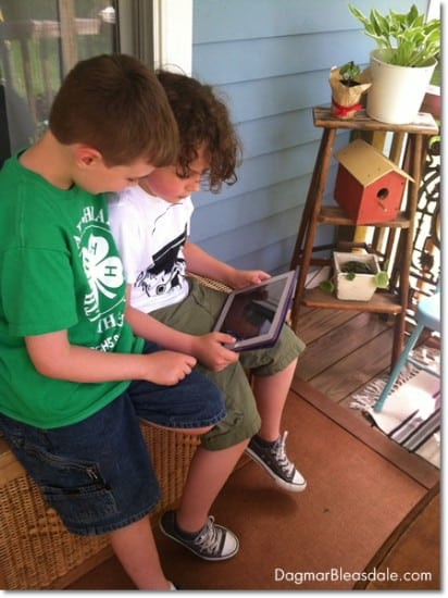 boys playing Minecraft on iPad