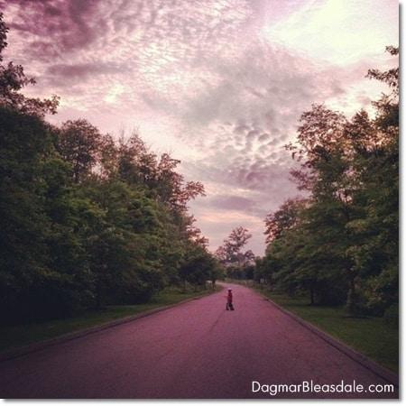 beautiful sky and boy on bike