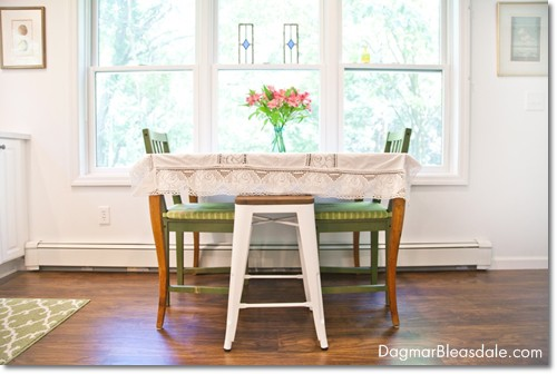 eat-in cottage kitchen with vintage table and IKEA chairs