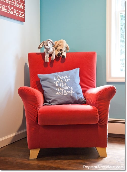 turquoise room, red chair