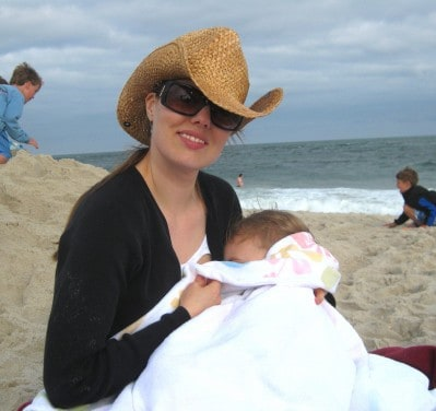 mom nursing toddler in public at the beach