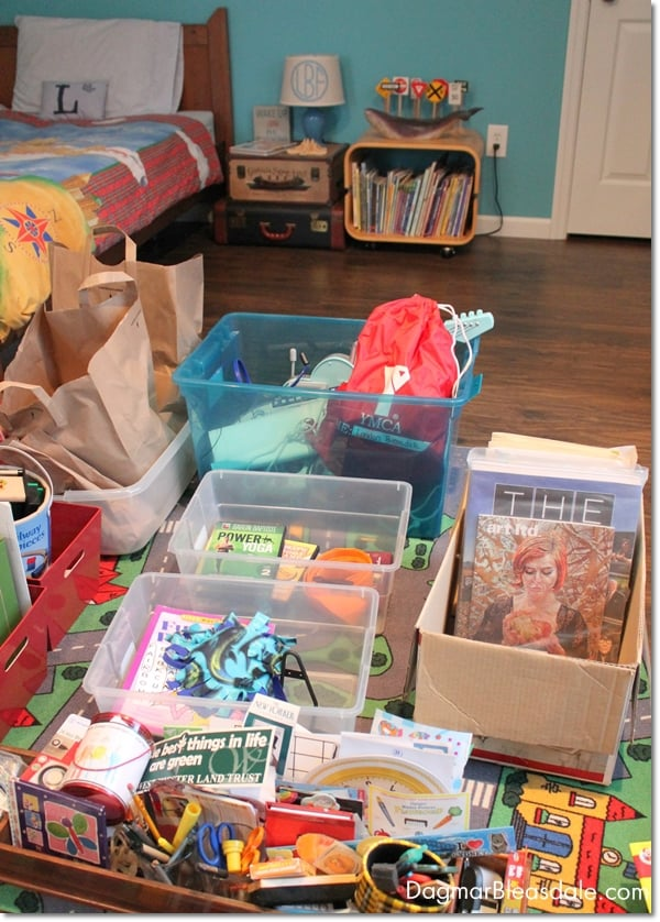 organizing kid's room with bins