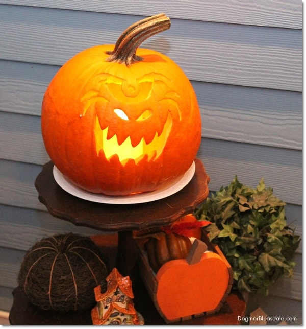carved pumpkin with candle