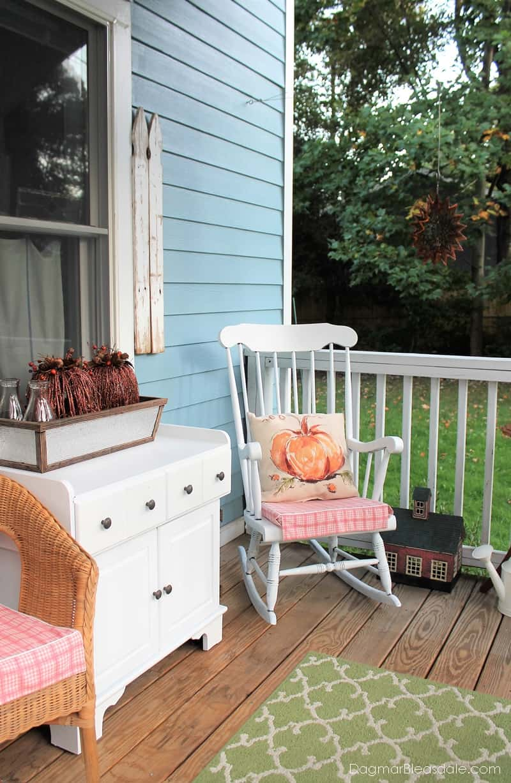 Vintage rocking chair on cottage porch
