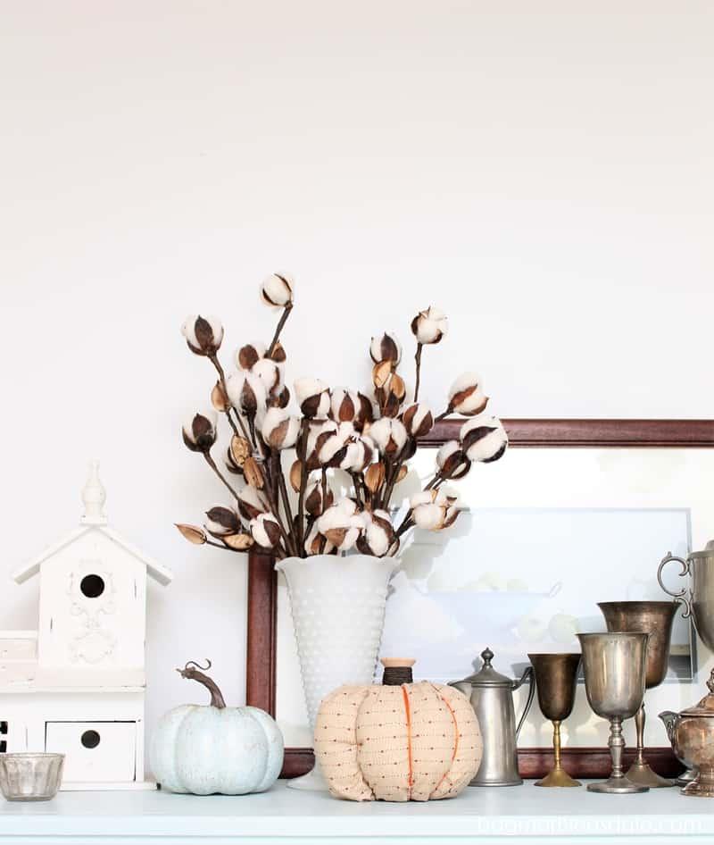 cotton stems in milk glass vase